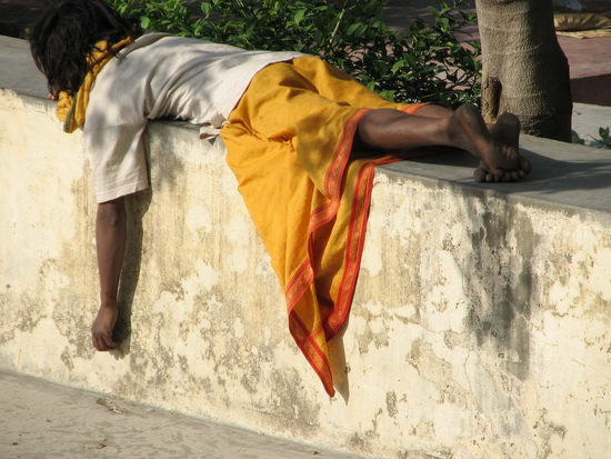 Man sleeping on wall