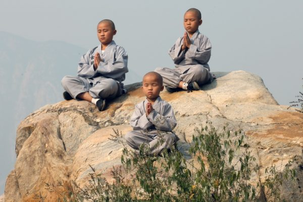 Young students learning to meditate on Song Mountain