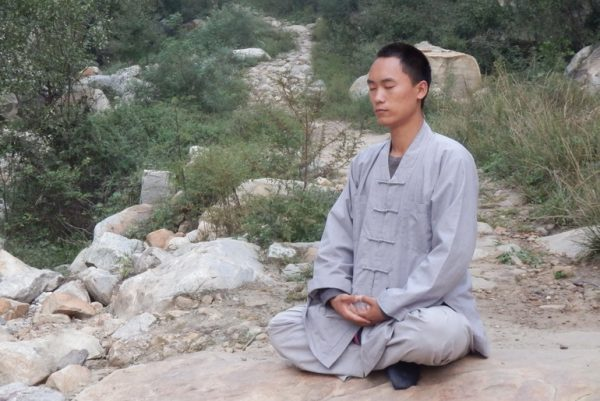 Head coach, Chengeng, meditating on the mountain