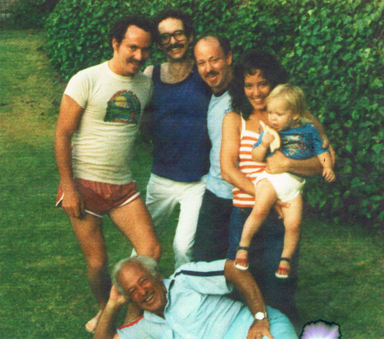 Dave, Bob, Billy and Laurie holding grand child. Brother Gill lying down