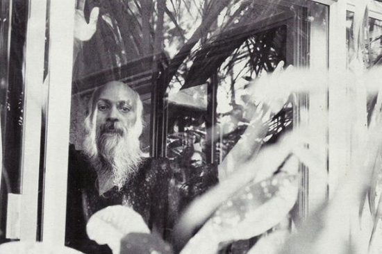 Osho looking out of his room