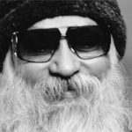 Osho with glasses
