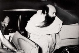 Osho stepping out of car