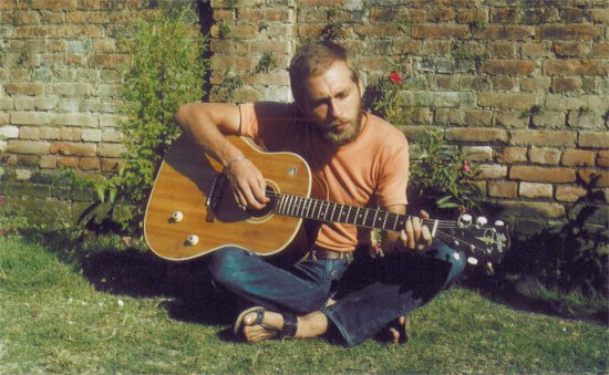 Bodhena playing guitar 1976