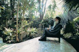 Osho sitting near the pond