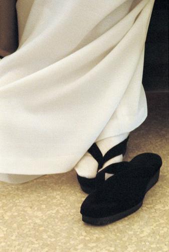 Osho's foot in sandal