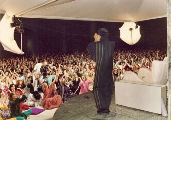 Osho greeting his disciples in Buddha Hall