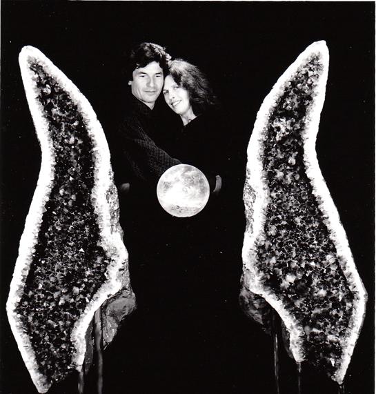 "Satdeva and Sitara pose with crystal ball and amethyst ""angel wings."""