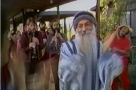 Osho dancing at Rajneeshpuram