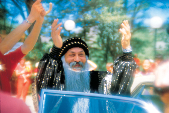 Osho greeting during drive-by