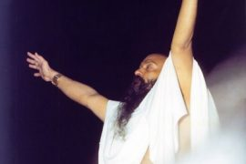 Osho conducting a meditation