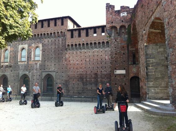 A posse of segways glide through il Castello Sforzesco, Milan