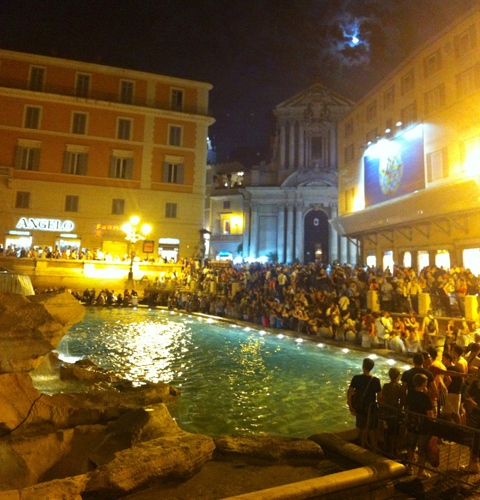 Trevi fountain under a full moon