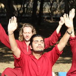 meditators with hands in air - Oshodham