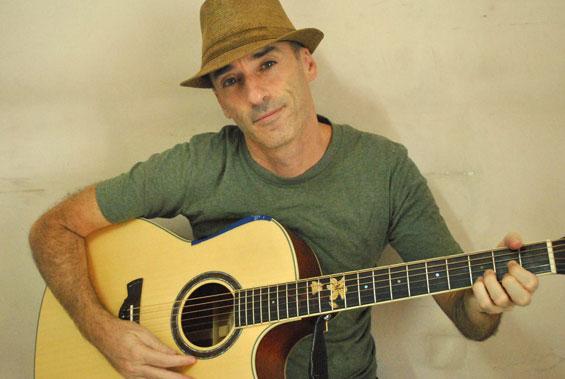 Arnavah playing guitar