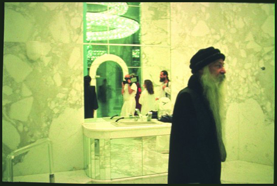 Osho visitng the new bathroom