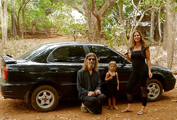 the family in front of the new car
