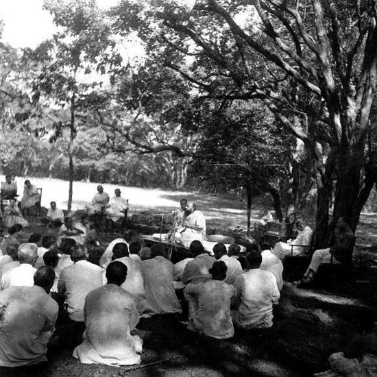Osho speaking at a meditation camp