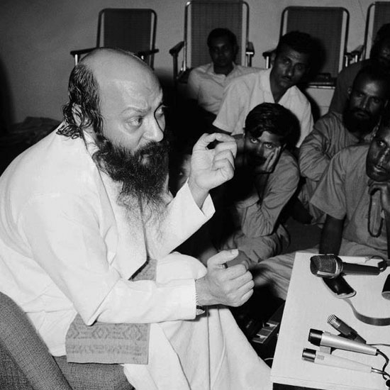 Osho speaking at a lecture