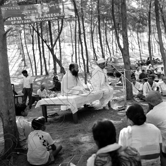 Osho speaking at an open air discourse