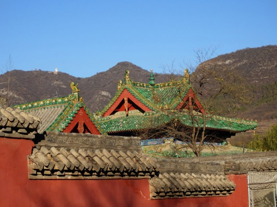 Roof of Shaolin Temple with Bodhidharma's cave and statue on Wuru Peak