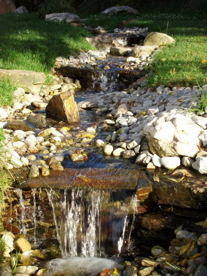 Stream running through the garden - with waterfalls