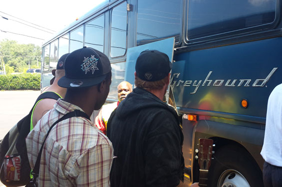 stepping into a Greyhound bus