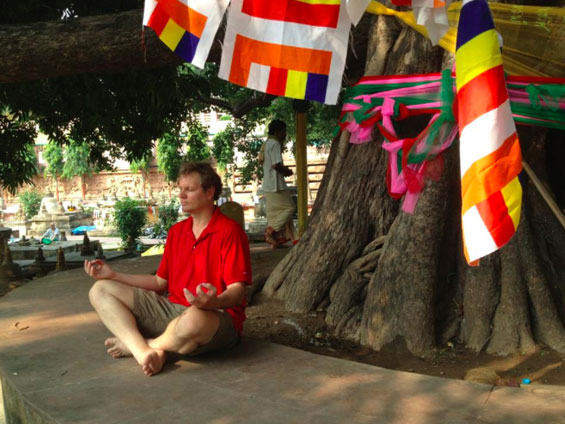 Terry Hodgkinson meditating under the Bodhi Tree, in Bodh Gaya