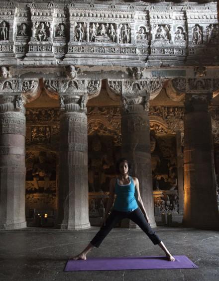 Chetna preparing for triangle pose: Ajanta Ellora Caves, India