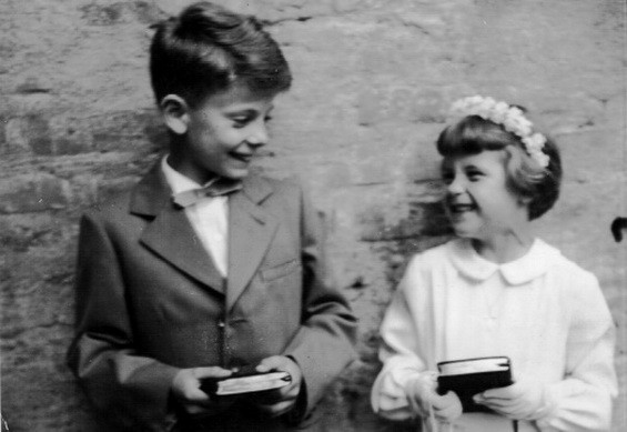 At age 8 with his sister at their First Communion
