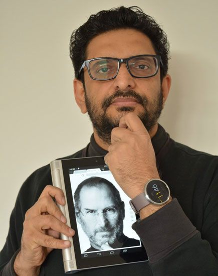 Niyam Bhushan with tablet and watch