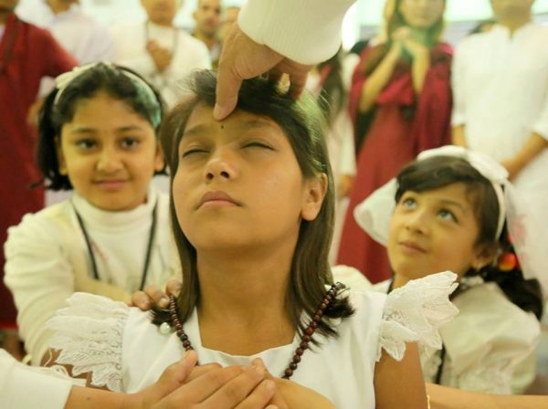 girl receiving initiation