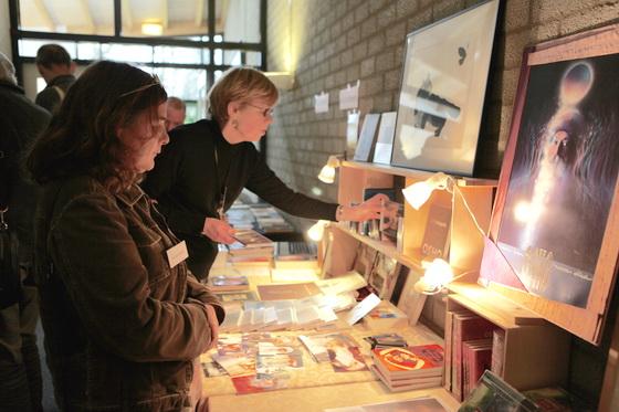 Visitors looking at book display