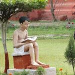 Statue of boy reading