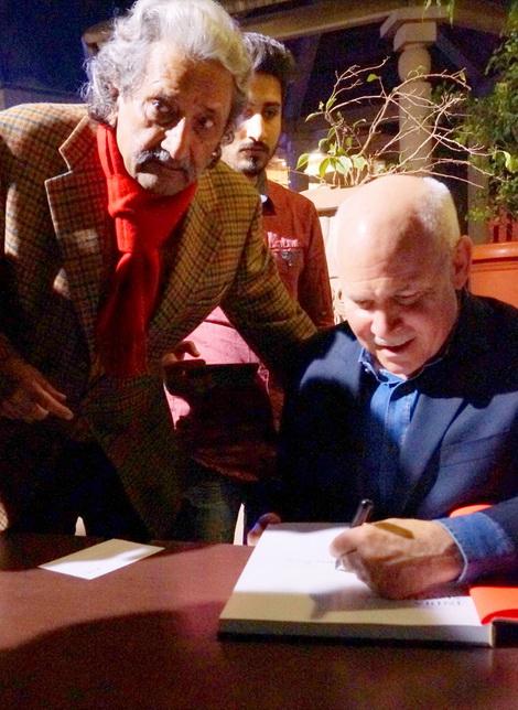 Steve McCurry signing Kul Bhushan's copy