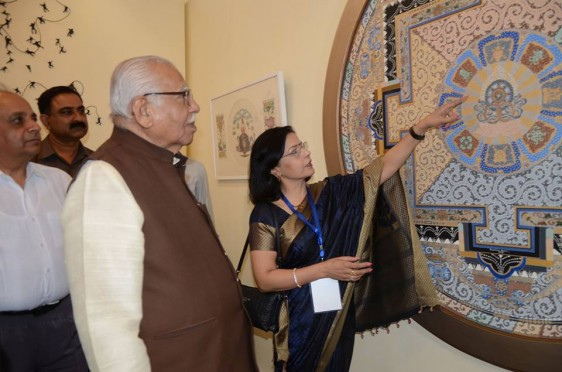 Pratiksha showing her painting 'Cosmic Balance'