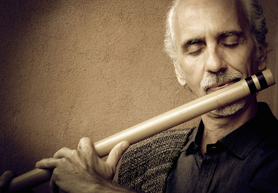 Shastro playing flute