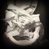 Toilet full of paper