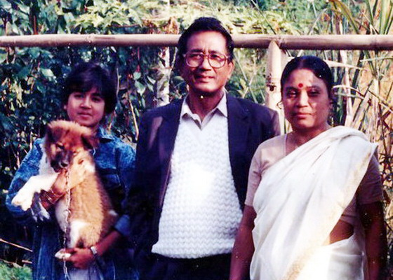 Naina as a child with her parents