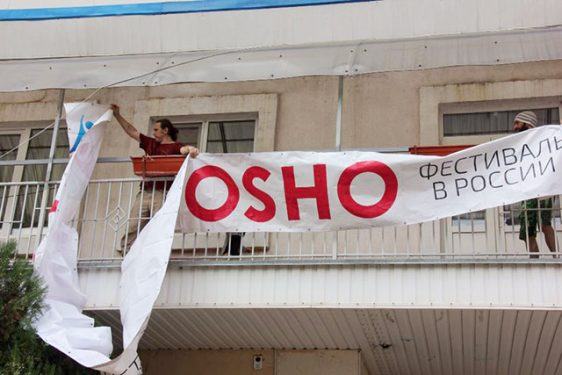 Hanging the Osho banner