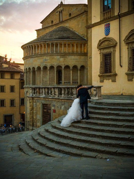 Wedding Selfie: Piazza Grande, Arezzo, Italy - These newlyweds took a selfie just as the sun was going down. Their guests were noticeably absent, which made the image.