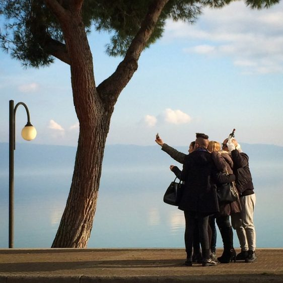 Christmas Selfie: Lake Trasimeno, Passignano, Italy - This rowdy group stopped for a selfie on Christmas day while some friends and I were having caffè.