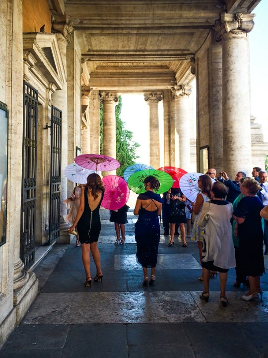 Parasols: Piazza Campidoglio, Rome, Italy - These wedding guests are just about to welcome the bride and groom. The timing was perfect.