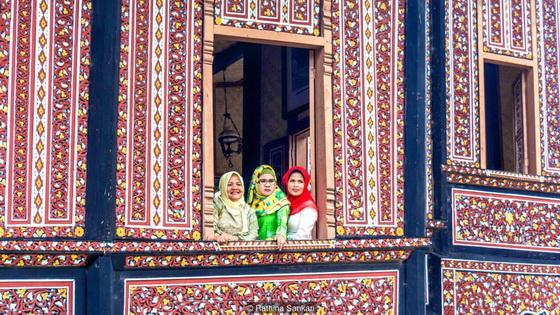 women-in-window