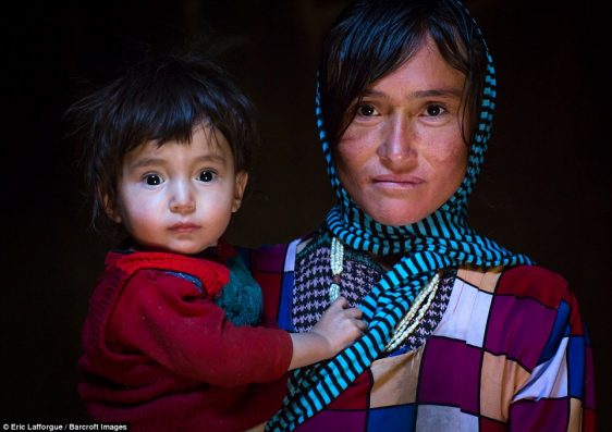 Portrait of an Afghan mother with her son