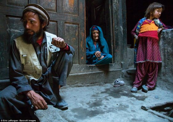 Afghan man with his old mother and his daughter in a Pamiri house