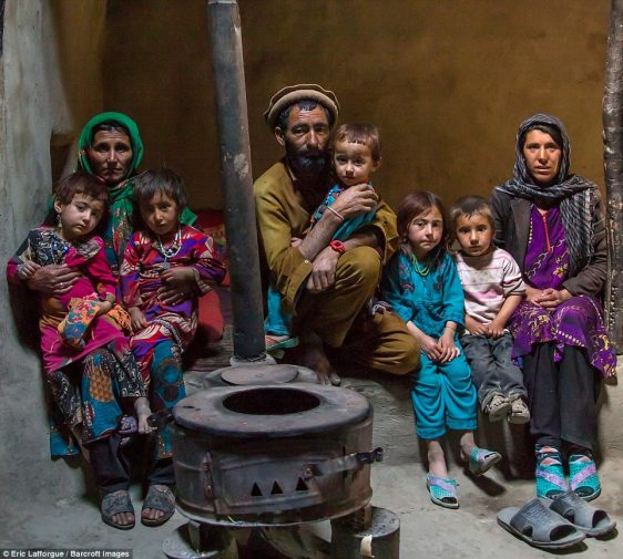 Afghan family in front of a stove in Wakhan