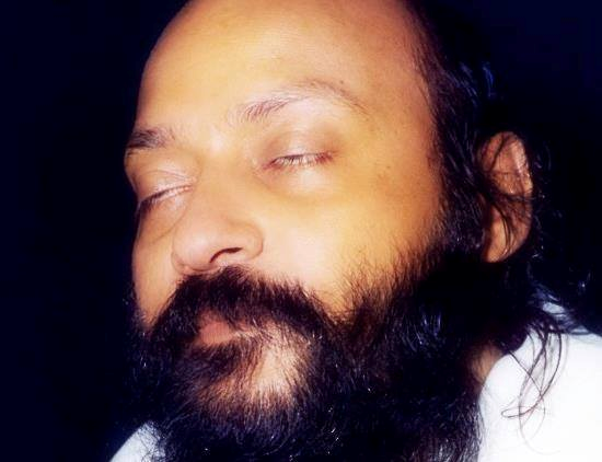 Osho with eyes closed