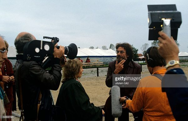 caption: Journalist Joerg Andrees Elten, Bhagwan disciple, giving a TV interview