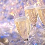Celebration with three champagne glasses